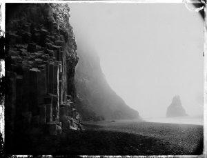 Rainy day at Reynisfjara black sand beach - south coast Iceland - sea stacks and columnar basalt - fine art polaroid photography by Guðmundur Óli Pálmason - Kuggur.com