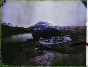 abandoned boat by a small bay in Iceland - fine art polaroid photography by Guðmundur Óli Pálmason - kuggur.com