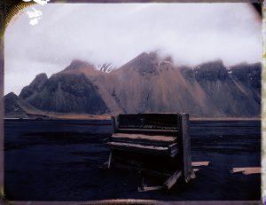 an abandoned piano on a black sand beach in south Iceland - fine art polaroid photography by Guðmundur Óli Pálmason - kuggur.com