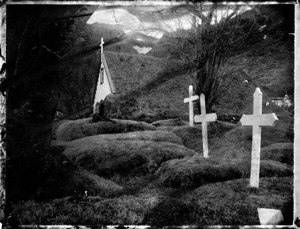 traditional Icelandic turf house church and graves - fine art polaroid photography by Guðmundur Óli Pálmason - kuggur.com
