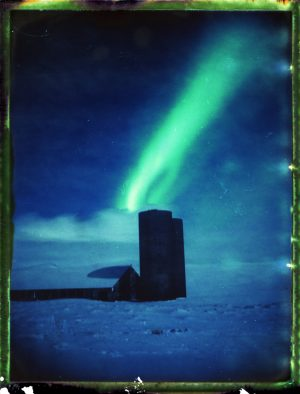 barn and cilo shed under the northern lights in Iceland - aurora borealis - fine art polaroid photography by Guðmundur Óli Pálmason - kuggur.com