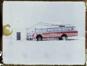 An old bus stands abandoned in the snow in rural Iceland - fine art polaroid photography by Guðmundur Óli Pálmason - Kuggur.com