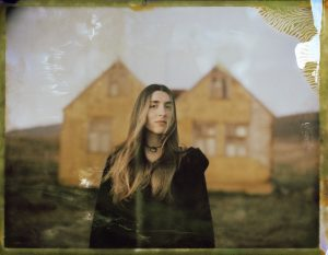 a woman in front of an abandoned farm in the mountains of northern iceland - fine art polaroid photography by Guðmundur Óli Pálmason Kuggur.com