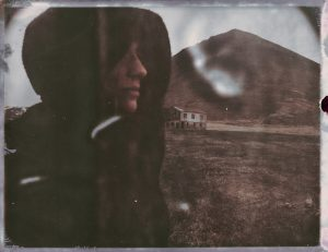 hooded person stands by an abandoned farm in iceland - fine art polaroid photography by Guðmundur Óli Pálmason Kuggur.com