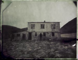 a person in front of an abandoned farm in the mountains of northern iceland - fine art polaroid photography by Guðmundur Óli Pálmason Kuggur.com