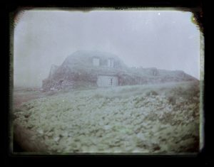 turf house farm in the fog in Iceland midnight sun Fine art Polaroid photography by Guðmundur Óli Pálmason kuggur.com