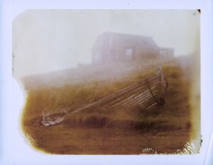 an old boat and an abandoned farm in Iceland at sunset midnight sun Fine art Polaroid photography by Guðmundur Óli Pálmason kuggur.com