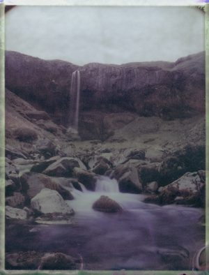 a secret waterfall surrounded by comumnar basalt in Iceland - Fine art Polaroid photography by Guðmundur Óli Pálmason kuggur.com