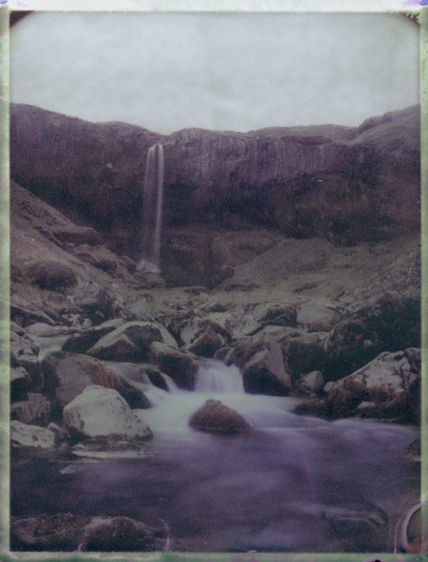 a secret waterfall surrounded by comumnar basalt in Iceland - Fine art Polaroid photography by Guðmundur Óli Pálmason kuggur.com