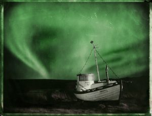 fishing boat under the northern lights in Iceland - aurora borealis - fine art polaroid photography by Guðmundur Óli Pálmason - kuggur.com