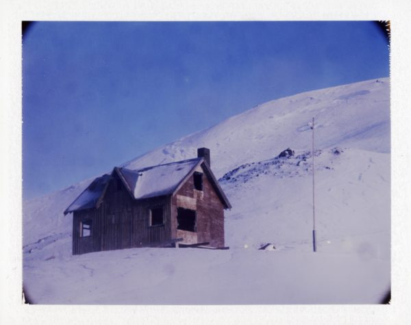 Abandoned farm in snowy mountains at winter in Iceland - Fine art Polaroid photography by Guðmundur Óli Pálmason kuggur.com