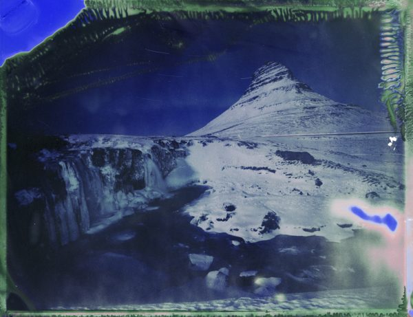 The famous Kirkjufell mountain and Kirkjufellsfoss waterfall in west Iceland at night Fine art Polaroid photography by Guðmundur Óli Pálmason kuggur.com