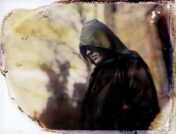 a dark figure of death by an abandoned church - corona art - fine art polaroid photography by Guðmundur Óli Pálmason - kuggur.com