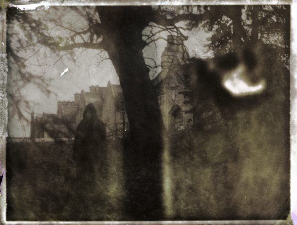 a dark figure of death by an abandoned castle - corona art - fine art polaroid photography by Guðmundur Óli Pálmason - kuggur.com