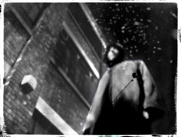 a dark figure of death - virus in the air - corona art - fine art polaroid photography by Guðmundur Óli Pálmason - kuggur.com