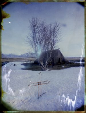Víðimýrarkirkja one of the last traditional Icelandic turf house churches. North Iceland. Fine art polaroid photography by Guðmundur Óli Pálmason - Kuggur.com